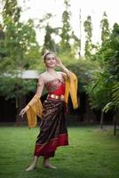 Woman wearing a typical Thai dress photo
