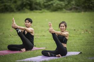 Couple doing yoga in the park photo