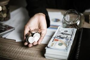 Silver coins and banknotes photo