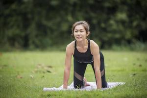 Woman doing yoga in the park photo