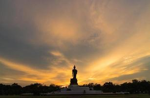 Large Buddha silhouette in Thailand at sunset