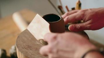 Potter Works on a Clay Teapot