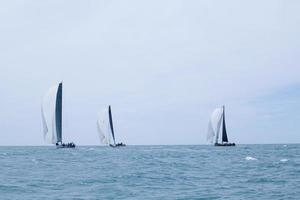 Chaweng beach, Thailand, May 25, 2019 - Three sailboats racing