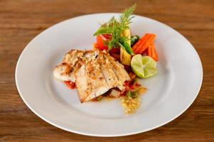 Fillet seabass meuniere with vegetable and potatoes photo