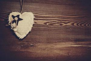 Love heart on wooden texture background photo