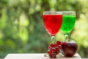 Glasses of juice with fruits
