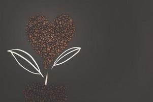 Coffee beans arranged in a heart shape
