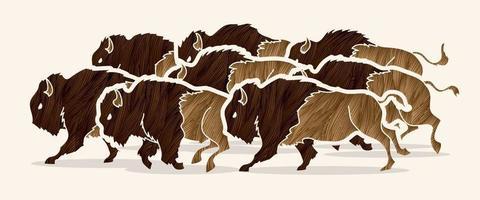 grupo de bisontes o búfalos corriendo vector