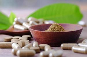 Herbal powder and medicine in wood bowl