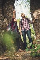 Hiker couple walking among trees photo