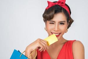 Portrait of a woman holding a credit card