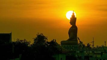 Sunset after the Buddha statue Orange evening sky
