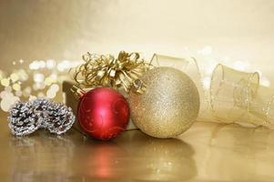 Christmas background with decorative baubles and gift