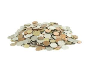 Pile of money coins isolated on white background photo