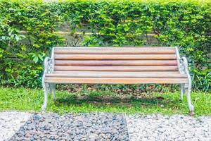 Empty bench in the park in summer photo