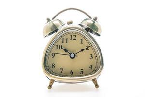 Alarm clock on white background photo