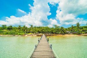 Wooden pier on tropical beach photo