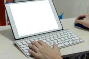 A girl using a computer keyboard. Studying online at home