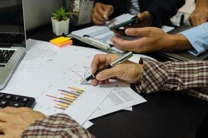 A business meeting to review documents and information on marketing and financial statements, reports, and business planning