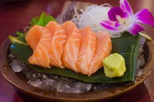 Fresh salmon sashimi plate with wasabi photo