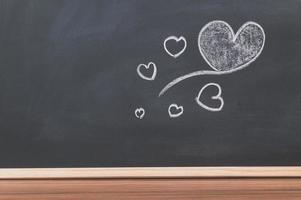 Heart doodles on the blackboard