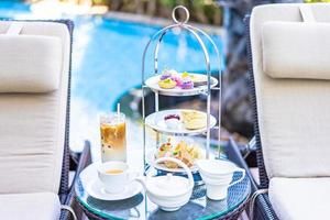 Afternoon tea set with latte coffee and hot tea photo