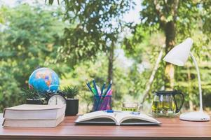 Books on the desk, nature background