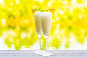 Ice cocktail glasses on wooden desk
