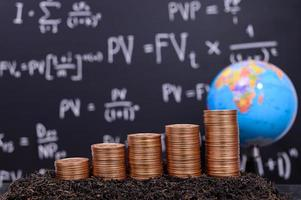 Coins in front of a blackboard