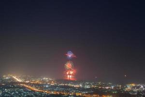 Fireworks above a city photo