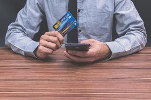 Businessmen using credit cards