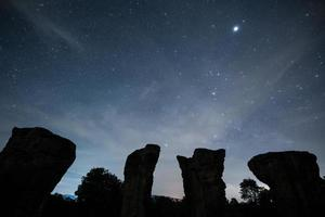 Silhouette of rocks in a starry sky photo