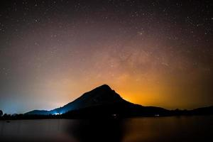 Starry sky over a mountain photo