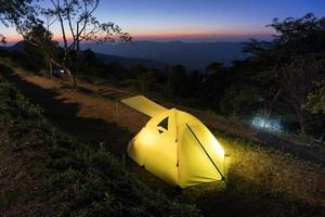 Camping tent on a mountain side photo