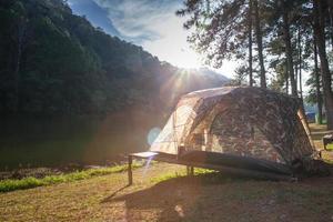 Tent in sunlight near mountains
