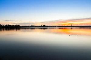Sunrise reflection in a lake photo