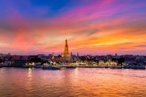 Bangkok, Thailand, 2020 - Colorful sunset on the Wat Arun temple