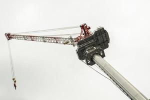Construction crane in the sky photo