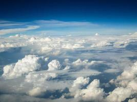 Aerial view of fluffy clouds photo