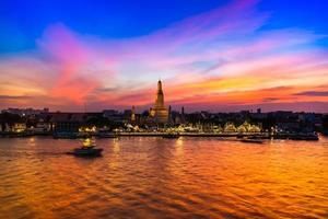 Bangkok, Thailand, 2020 - View of the Wat Arun temple at sunset