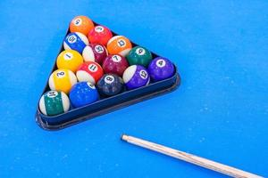 Billiard balls on blue table photo