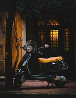 Vespa motor scooter parked