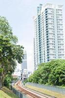 View of railroad tracks and tall buildings in Kuala Lumpur, Malaysia