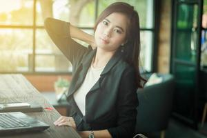 Asian business woman working in a cafe