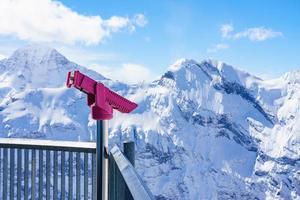 Prismáticos que funcionan con monedas en Murren, Suiza foto