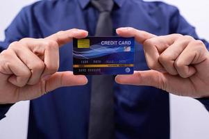 Businessman holding a credit card