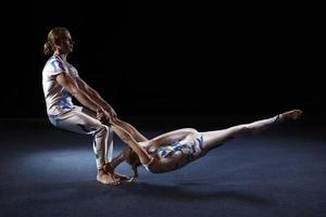 Gymnasts performing together photo