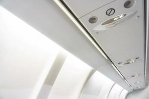 Fasten Seat belt sign on a plane photo