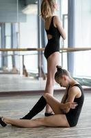 Two young ballet dancers in a studio
