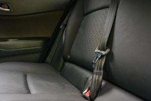 Modern car interior, rear seats with seat belts photo
